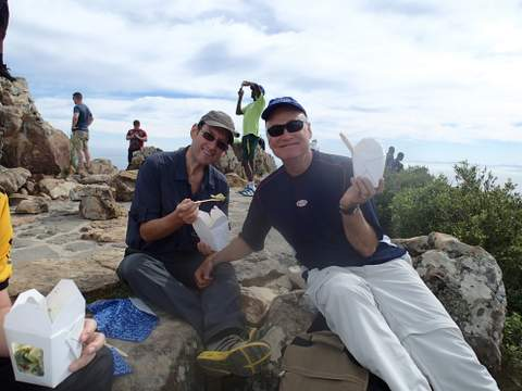 JP Fluckiger (right) and Brian Berkman munching chicken salad with brocolli and great coffee carried all the way to the top of Lion's Head.