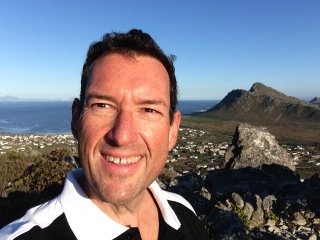 On top of the Kogelberg with Pringle Bay bay in the background.